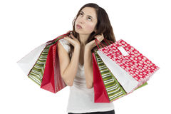 tired-bored-shopping-woman-looking-holding-paper-bags-isolated-white-background-49013450